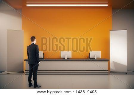Businessman In Interior With Reception