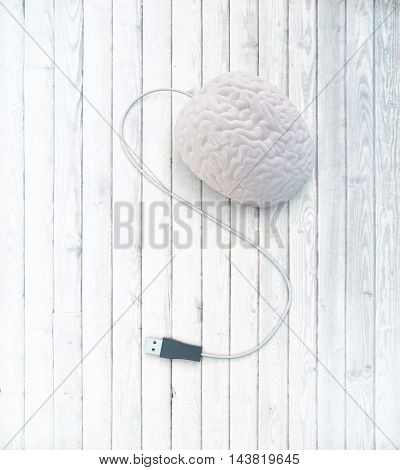 Brainstorming concept with abstract human brain usb plug on white wooden surface. 3D Rendering
