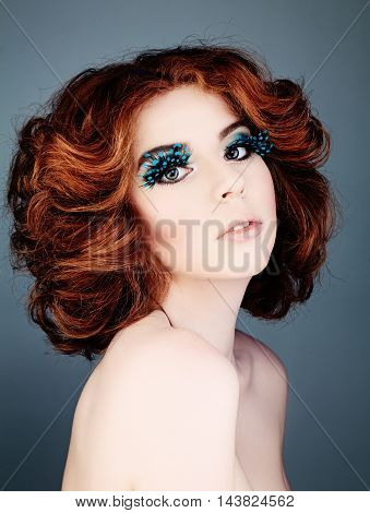 Nice Woman with Red Hair and Feathers Eyelashes