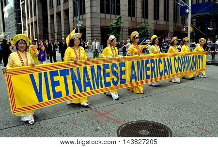 New York City - June 22 2013: Vietnamese contingent marching in the International Immigrants Foundation Parade on Avenue of the Americas
