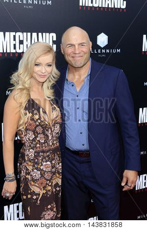 LOS ANGELES - AUG 22:  Mindy Robinson, Randy Couture at the