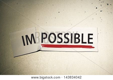 motivation success and positive thinking concept with word impossible turned into possible