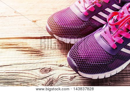 Pair of sport shoes on grey wooden background, Sport accessories and fashion, Healthy lifestyle. Toned.