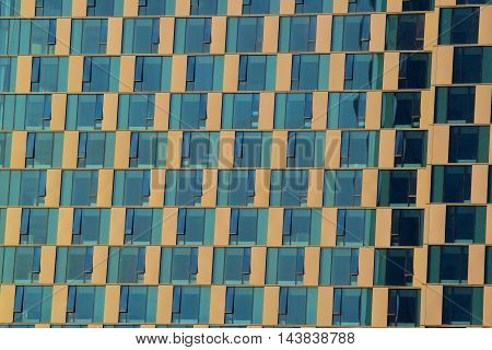 Contemporary style windows creating abstract background patterns taken on a highrise building