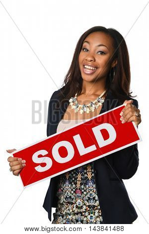 Portrait of beautiful African American businesswoman holding sold sign isolated over white background