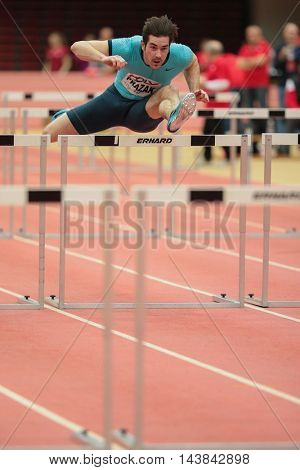 LINZ, AUSTRIA - FEBRUARY 6, 2015: Manuel Prazak (#257 Austria) competes in the men'S 60m hurdles event in an indoor track and field event.