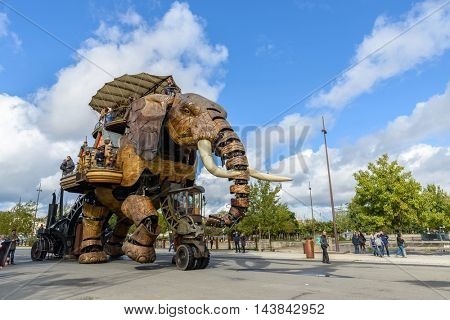 NANTES, FRANCE - CIRCA SEPTEMBER 2015: The Great Elephant goes for a walk with passengers aboard.