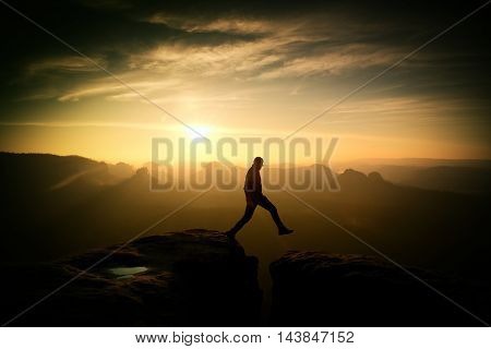 Crazy Hiker Jump. Wonderful Daybreak In Rocky Mountains,