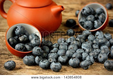 Fresh ripe blueberries on a wooden background selective focus