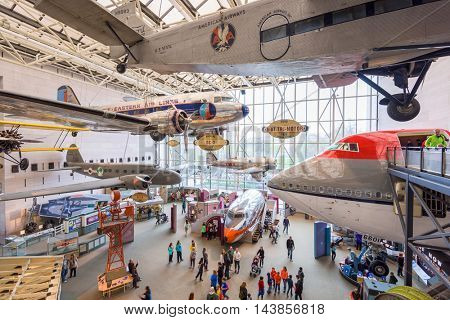 WASHINGTON DC - APRIL 8, 2015: Visitors enjoy The National Air and Space Museum of the Smithsonian Institution in Washington DC.