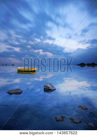 A Yellow Dinghy Floats On The Stormy Blue Where Sky Meets Sea Composite Image Digital Art