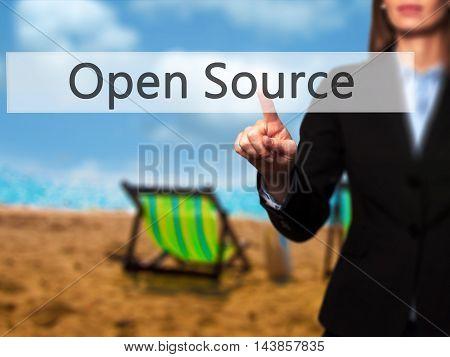 Open Source - Businesswoman Pressing Modern  Buttons On A Virtual Screen