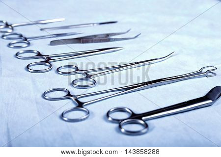 Medical instruments for dentists on blue table