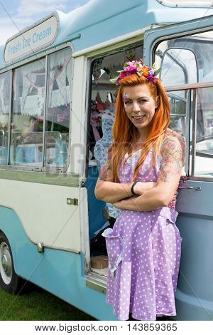 Ginger Haired Lady Standing With Vintage Ice Cream Van