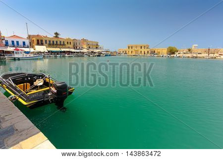 Rethymnon, Island Crete, Greece, - July 1, 2016: View of the harbor with small  ships and the moored powerboat. Rethymnon is an old historic town on the northern coast of the island Crete.