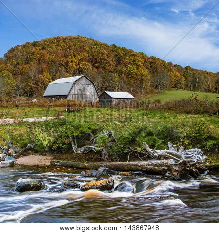 A Pastoral Landscape Barn And River Below A Hill In Autumn Central Ohio USA