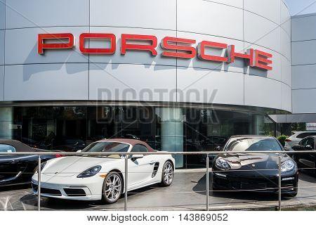 Porsche Automobile Dealership And Cars
