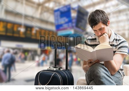Delayed Train Concept. Passenger Is Sitting In Train Station, Re