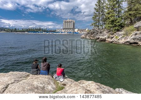Family enjoying the view of Coeur d'Alene lake and the resort from Tubbs Hill.