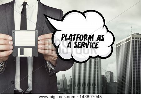 Platform as a service text on speech bubble with businessman holding diskette