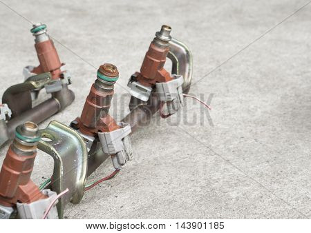 Old and used fuel injectors and fuel injector rail for gasoline engine selective focus poster