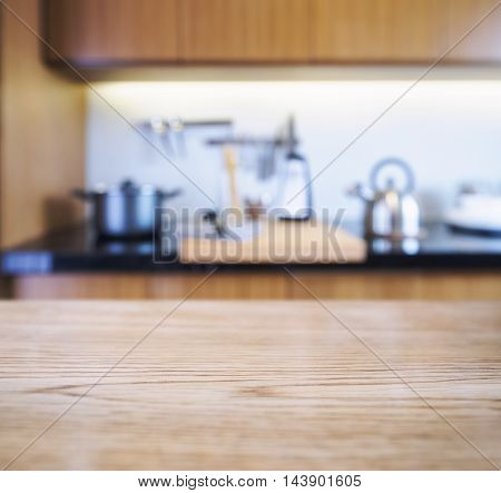 Table top with Blur Kitchen Pantry with kitchenware cooking background