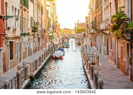 Small romantic water canal in Dorsoduro region in Venice