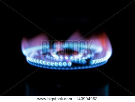 gas burning from a kitchen gas stove in dark