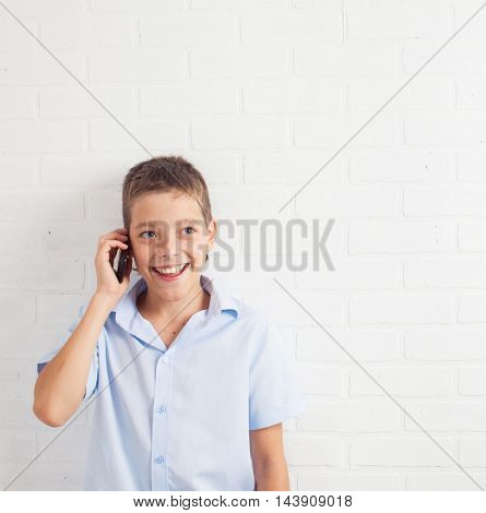 Boy talking mobile  phone. Happy teenager