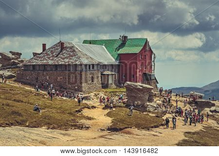 Bucegi Mountains Romania - August 6 2016: Thousands of tourists hike the trails to the Babele (The Old Women) chalet at 2206 m altitude in Bucegi Mountains to visit the Babele Rocks and the Sphinx.