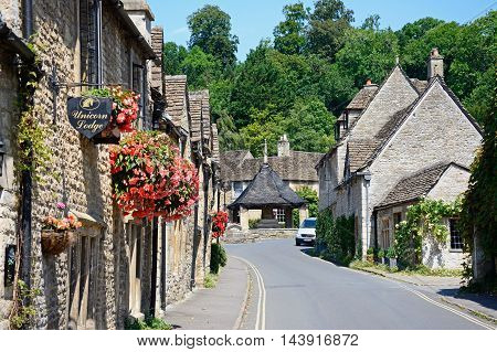 CASTLE COMBE, UNITED KINGDOM - JULY 20, 2016 - View along the main village street towards the fourteenth century market cross in the village centre Castle Combe Wiltshire England UK Western Europe, July 20, 2016.