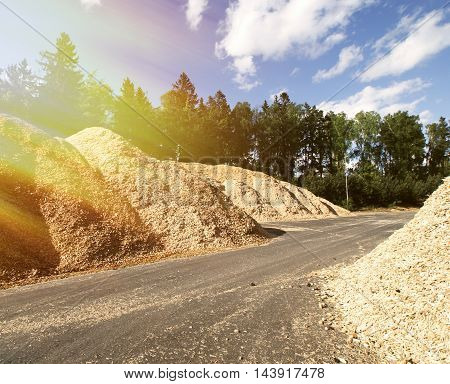 Storage Of Wooden Fuel Against Blue Sky