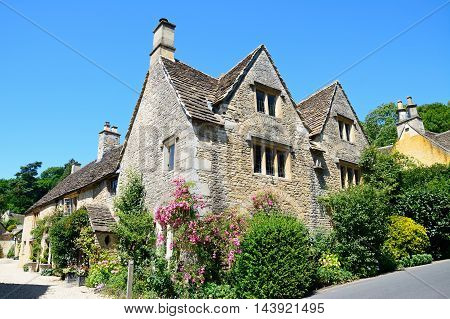CASTLE COMBE, UNITED KINGDOM - JULY 20, 2016 - Cotswold stone buildings in the village centre Castle Combe Wiltshire England UK Western Europe, July 20, 2016.