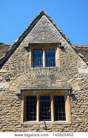 Cotswold stone cottage built in 1672 in the village centre Castle Combe Wiltshire England UK Western Europe.