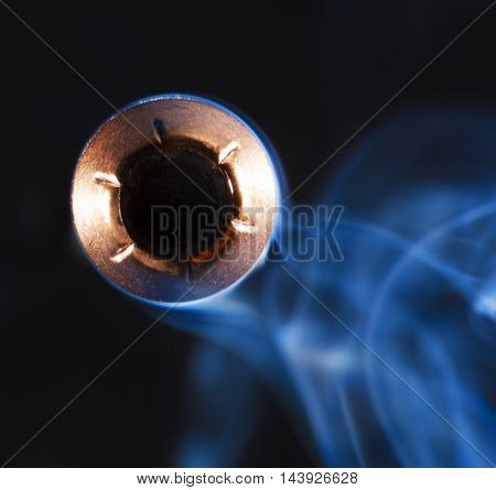 Hollow point bullet and smoke that look like they are coming at the camera