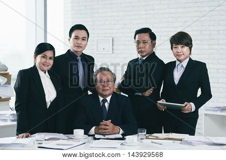 Team of lawyers with their senior leader in the middle