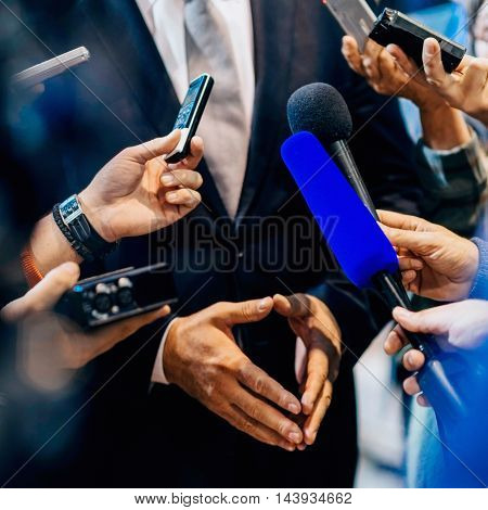 Media interview with business person, toned image