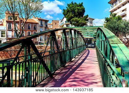 Spring in the Perpignan city. Footbridge across the city canal in the Perpignan. Pyrenees-Orientales, France