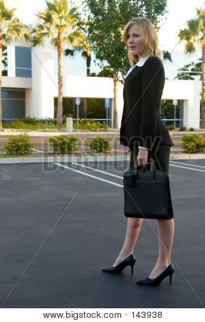 Business Woman Standing In Parking Lot
