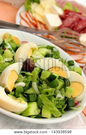 Green salad with eggs - close up