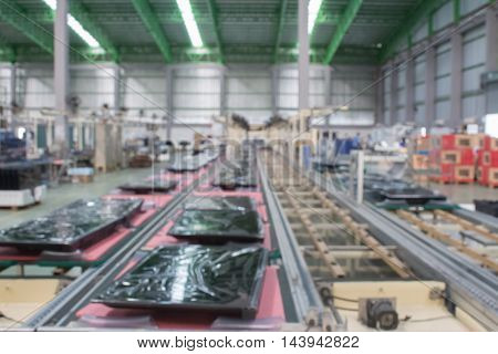 conveyor line Assembly TV. blur picture.manufacturing, production, plant,