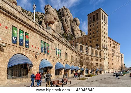 MONTSERRAT SPAIN - MARCH 6 2012: Benedictine abbey of Santa Maria de Montserrat located on the mountain of Montserrat nearby from Barcelona