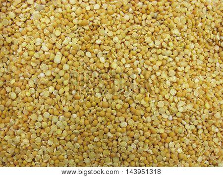 Dry peas. Background of halves dry peas. Scattered peas. Peas as background.