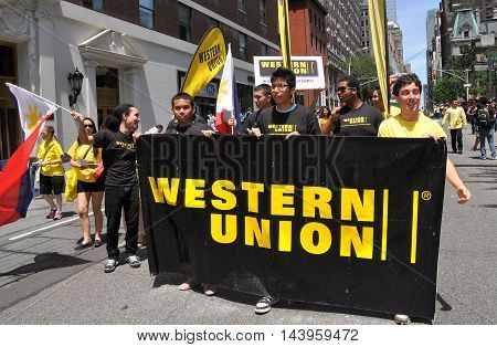 New York City - June 3 2012: Western Union marchers with their company banner at the Philippines Independence Day Parade on Madison Avenue