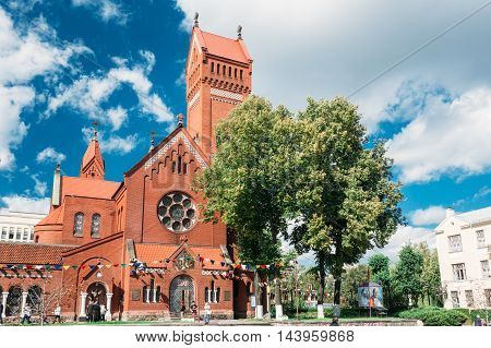 Minsk, Belarus - August 27, 2014: Belarussian Catholic Church Of Saints Simon And Helen - Red Church On Independence Square In Minsk, Belarus