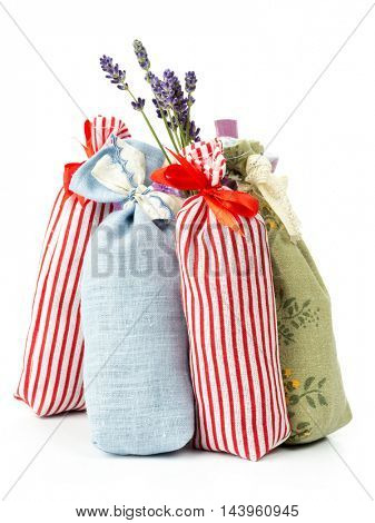 Group of decorative pouches staffed with dried lavender on white background