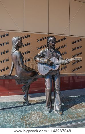YEKATERINBURG RUSSIA - AUGUST 24 2013. Musical monument to the great Russian poet singer and actor Vladimir Vysotsky and French actress Marina Vlady