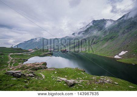 Balea Lake next to Transfagarasan Road in southern section of Carpathian Mountains in Romania