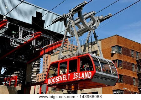 New York City - August 31 2011: The  Roosevelt Island tram filled with passengers arriving at the Second Avenue and East 59th Street station following its crossing of the East River to Manhattan