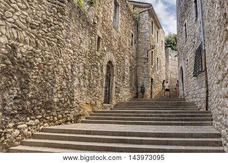 GIRONA SPAIN - JULY 6 2016: Ancient medieval street in Girona Catalonia Spain
